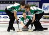 Ashley Howard, third for Team Saskatchewan, delivers a rock during the Scotties Tournament of Hearts in Grande Prairie, Alta.  Howard joins her father, uncle, brother and cousin in playing at a Canadian national curling championship. (LOGAN CLOW/Postmedia Network)