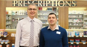Craig Brown, left, stands with Scott Gillingham. Brown, who has been a pharmacist in Vermilion for 34 years, sold his business, Apple Drugs, to Shoppers Drug Mart. Gillingham will act as the new owner and pharmacist.