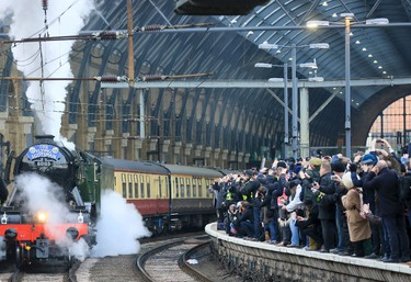 """The Flying Scotsman steam engine leaves Kings Cross station in London, February 25, 2016. Locomotive 60103 Flying Scotsman made its official return to steam with a celebratory """"Inaugural Run"""" along the East Coast Mainline after a decade-long 4.2 million British Pounds ($5.8 million) restoration. REUTERS/Paul Hackett"""