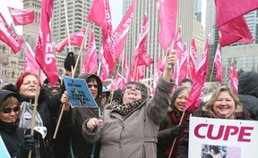 CUPE Local 79 and supporters rally in Nathan Phillips Square on Thursday, February 25, 2016 as contract talks continue with the city. (Veronica Henri/Toronto Sun)