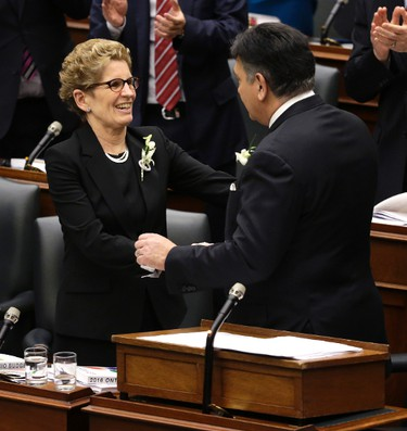 Minister of Finance Charles Sousa gets a hug from Premier Kathleen Wynne after presenting the 2016 Ontario Budget in Toronto, Ont. on Thursday February 25, 2016. Craig Robertson/Toronto Sun/Postmedia Network