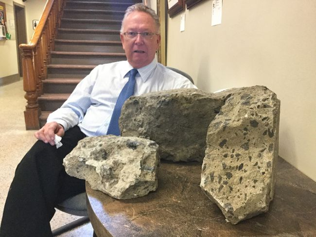 SUBMITTED PHOTO Prince Edward County Mayor Robert Quaiff is pictured at Shire Hall with chunks of concrete he removed from County Road 49.