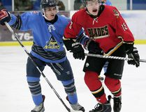 Blenheim Blades' Dustin Maines, right, fights for position with Amherstburg Admirals' Broden Meloche in Game 1 of their Great Lakes Junior 'C' Hockey League semifinal Feb. 23, 2016, at Blenheim Memorial Arena. (MARK MALONE/The Daily News)