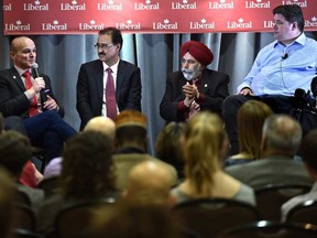 From left, Liberal MPs Randy Boissonnault, Amarjeet Sohi, Minister of Infrastructure and Communities, Darshan Kang and Kent Hehr at the Liberal Party of Canada 2016 Policy Convention in Edmonton, February 27, 2016.