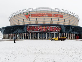 A Canadian Tire Centre employee stands in front of the building while the doors are open to vent out the building during an evacuation this morning due to a foul odour. The Hazmat team was called on site prior to the start of a Disney On Ice show in Ottawa on February 28, 2016. (Jana Chytilova/Postmedia Network)