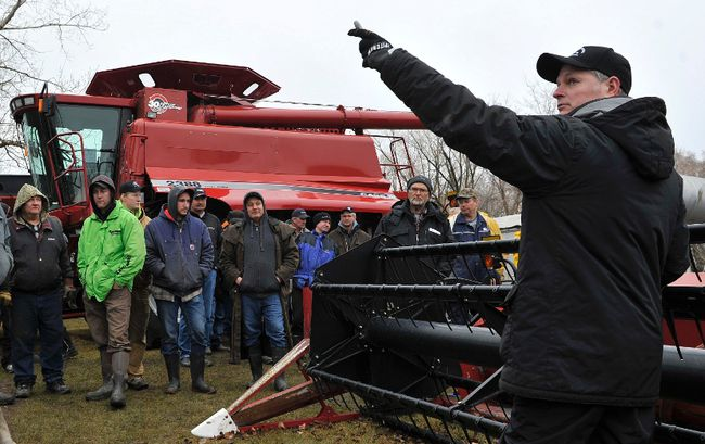 <p>Darrell Wheeler, right, spots bidders during a farm auction near Fannystelle, Man. in this April 2014 file photo. </p><p>Reuters/ file photo/Cornwall Standard-Freeholde