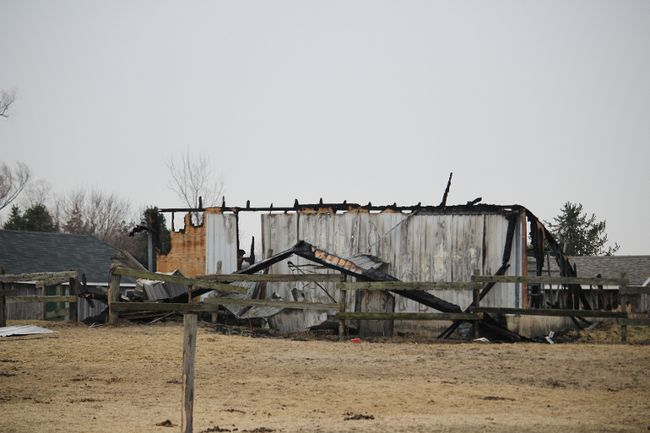 The only remains of a barn south of Otterville that was destroyed in a fire early Saturday morning. All nine horses in the barn died. An online fundraiser has been set up to help the owner of Darkin Riding Stables rebuild. (MEGAN STACEY/Sentinel-Review)