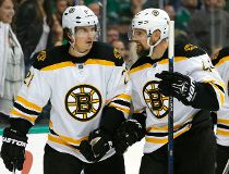 Boston Bruins' Loui Eriksson (21), of Sweden, and Dennis Seidenberg (44), of Germany, celebrate after Ericsson scored a goal against the Dallas Stars in the second period of an NHL hockey game, Saturday, Feb. 20, 2016, in Dallas. (AP Photo/Tony Gutierrez)