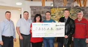 Union Gas presented a cheque in the amount of $43,211 to the Cochrane District Social Services Administration Board at the Cochrane Senior Retirement Living Complex located at 500 Twelfth Avenue North in Cochrane. The rebate payment is courtesy of the Union Gas's Affordable Housing Conservation Program. Norm Ellerton of Union Gas, Derrick Gourley and Lee-Ann St. Jacques of CDSSAB, Michel Vezeau of CGV Builders, Gerald Laforest and John Davidson of Union Gas were an hand for the presentation.