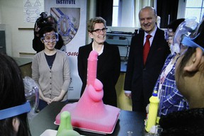 EXCITED ABOUT FREE TUITION: Premier Kathleen Wynne gets an eyeful as a science experiment produces interesting results at Jarvis Collegiate in Toronto on March 1, 2016.