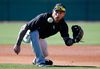 Chicago White Sox's Brett Lawrie fields a ground ball during a spring training workout Wednesday, Feb. 24, 2016, in Glendale, Ariz. (AP Photo/Ross D. Franklin)