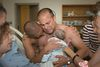 BJ Barone and Frank Nelson hold their baby Milo after his birth in 2014 to a surrogate mother.
