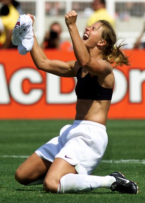 U.S. midfielder Brandi Chastain, with her jersey off, celebrates her winning penalty kick against China at the Women's World Cup Final at the Rose Bowl in Pasadena, Calif., on July 10, 1999. Chastain  (Mike Blake/Reuters/Files)