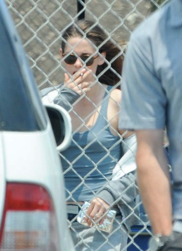 """2013: Kristen Stewart takes a smoke break with a busted lip on the set of """"Camp X Ray."""" (Cousart/JFXimages/WENN.COM)"""