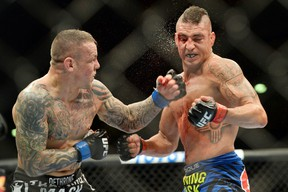 Diego Sanchez (right) takes a left hook from Ross Pearson during their lightweight bout during UFC Fight Night 42 at Tingley Coliseum in Albuquerque, N.M., on June 7, 2014. (Joe Camporeale/USA TODAY Sports)