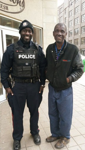 Toronto Police Const. Ed Parks poses with Cleo after he helped him with a meal at Tim Hortons. (Twitter)