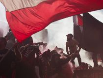 Toronto FC fans are pictured through the haze of a smoke flare during the team's 2-0 defeat to Columbus Crew in MLS action in Toronto on Saturday, October 17, 2015. THE CANADIAN PRESS/Chris Young