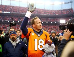 Denver Broncos quarterback Peyton Manning (18) waves to the crowd after the AFC Championship football game against the New England Patriots at Sports Authority Field at Mile High. Mark J. Rebilas-USA TODAY Sports/Files