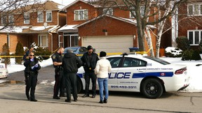 Peel Regional Police outside a home on Harrowsmith Dr. in Mississauga, in the Eglinton and Confederation area, Saturday, March 5, 2016 after a man was found stabbed. He later died in hospital. (Pascal Marchand/Special to the Toronto Sun)