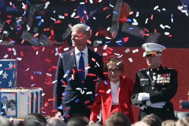 Confetti falls near former U.S First Lady, Nancy Reagan, who is flanked by Chairman of the Reagan Foundation, Fredrick Ryan, Jr. (L) and U.S. Marine Corps Lieutenant General George Flynn after the singing of Happy Birthday during the posthumous celebration of the 100th birthday of former U.S. president, Ronald Reagan, at the President Reagan Memorial Site at Reagan Library in Simi Valley, California. February 6, 2011.   REUTERS/David McNew