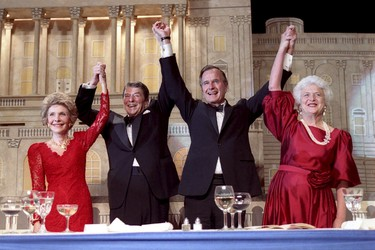 U.S. President Ronald Reagan (2nd L) and Vice President George Bush (2nd R), accompanied by their wives Nancy (L) and Barbara respectively, join hands after Reagan endorsed Bush's run for the presidency during the President's Dinner in Washington, DC in this May 11, 1988 handout photo obtained by Reuters November 30, 2012.   REUTERS/George Bush Presidential Library and Museum/Handout/Files