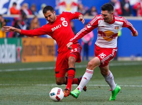Toronto FC defender Steven Beitashour and New York Red Bulls midfielder Sacha Kljestan battle for the ball during first-half action at Red Bull Arena in Harrison, N.J., on March 6, 2016. (Noah K. Murray/USA TODAY Sports)