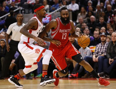 Houston Rockets James Harden (13) goes inside on Toronto Raptors Terrence Ross (31) and gets the foul in the fourth quarter - he had 40 points on the night. Rockets break Raptors 12-win home streak  winning 113-107 in Toronto, Ont. on Sunday March 6, 2016. Jack Boland/Toronto Sun/Postmedia Network