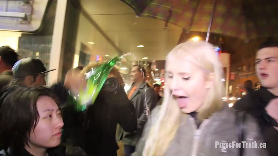 Rebel reporter Lauren Southern had a bottle of urine poured on her at a protest in Vancouver on Friday, March 4, 2016. (YouTube video screenshot)
