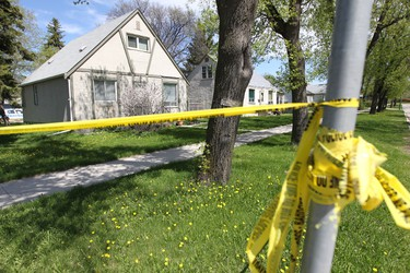 Police investigate the death of Gina Swanson, 33, whose body was found inside her home in the 1300 block of Edderton Avenue.