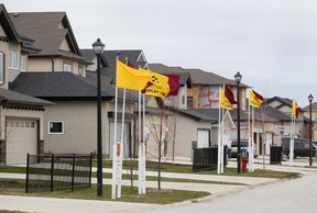 A group of display homes is seen in the Amber Trails area of Winnipeg, Man. Monday Nov. 4, 2013. The city is considering putting a heavy tax on new home purchases to offset infrastructure costs.