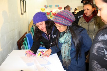 """Amanda Freeman, left, maps out a route for one of the about 30 people who turned out Tuesday night at the Kenora Fellowship Centre to search for Delaine Copenace, a 16-year-old missing girl who was last seen Saturday, Feb. 27 when she left the home she shares with her mom Anita and sisters to take a walk with some friends around 6 p.m. Anita started to worry about her daughter a few hours later and reported her missing on Sunday at about 2 a.m. """"It's out of character for her to be gone for three days,"""" said Anita. """"She's a good kid and has never runaway."""" Anyone who has information as to Delaine's whereabouts should call Crimestoppers at 1-800-222-TIPS (8477).  SHERI LAMB/Daily Miner and News/Postmedia Network"""