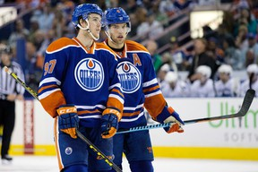 The Edmonton Oilers' Connor McDavid (97) and Taylor Hall (4) during third period NHL action against the Vancouver Canucks at Rexall Place, in Edmonton Alta. on Thursday Oct. 1, 2015. The Canucks won 5-2. David Bloom/Edmonton Sun/Postmedia Network