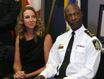 Police Chief Devon Clunis and wife Pearlene listen during a press conference at the Public Safety Building in Winnipeg to announce his retirement from the force on Thu., March 10, 2016.