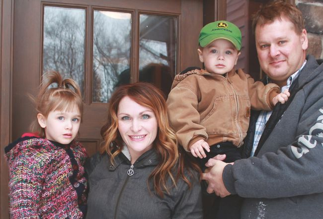 Jason and Laura Kehler, along with their children Paisley (age four-and-a-half) and Wyatt (two) are Manitoba's 2016 Outstanding Young Farmers. (EMILY DISTEFANO/CARMAN VALLEY LEADER)