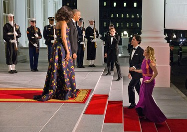 President Barack Obama and first lady Michelle Obama wait to greet Canadian Prime Minister Justin Trudeau and Sophie Gregoire Trudeau at the North Portico of the White House in Washington, Thursday, March 10, 2016, for a state dinner. (AP Photo/Jacquelyn Martin)