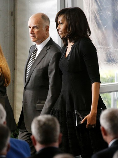 California Gov. Jerry Brown, left, and first lady Michelle Obama arrive at the funeral service for Nancy Reagan at the Ronald Reagan Presidential Library, Friday, March 11, 2016 in Simi Valley, Calif. (AP Photo/Jae C. Hong)