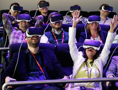 People test Samsung Gear VR glasses at their stand during the Mobile World Congress in Barcelona, Spain Feb. 23, 2016. REUTERS/Albert Gea
