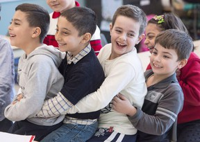 Syrian refugees Jamil Haddad, left, and Tony Batekh, 2nd left, George Louka and Edmon Artin, right, have some fun while they attend French classes at a school Wednesday, February 17, 2016 in Montreal. There are now just over 25,000 Syrian refugees who've arrived in Canada since the Liberal government rolled out its $678-million plan for refugee resettlement in November that targeted having that many people here by the end of this month. THE CANADIAN PRESS/Ryan Remiorz
