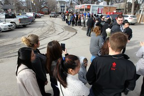 A long lineup on the opening day at the Bridge Drive-In on Jubilee Avenue in Winnipeg on Sat., March 12, 2016. Kevin King/Winnipeg Sun/Postmedia Network