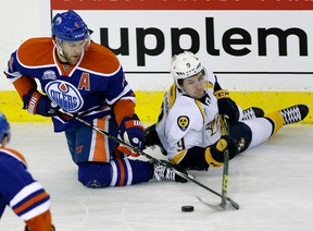 Taylor Hall and Nashville Predators winger Filip Forsberg battle for the puck during the first period Monday at Rexall Place. (Larry Wong)