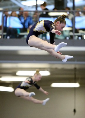 Edge gymnasts Jessica Preus (foreground) and Charlie Hodges compete in the synchronized trampoline event at the Airdrie Edge Gymnastics Club during the Tumbling & Trampoline Alberta Cup #3 on Sunday, Mar 13, 2016 in Airdrie, Alta. Britton Ledingham/Airdrie Echo/Postmedia Network