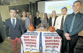 Representatives of the teams involved in the AAAA Manitoba high school basketball championships pose at a press conference Tuesday.