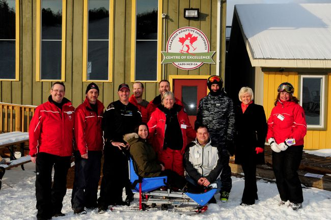 Renfrew-Nipissing-Pembroke MP Cheryl Gallant recently visited Calabogie Peaks Resort to announce they had received funding through the federal Enabling Accessibility Fund. In the photo from left, Geoff Cousens, Michael Stagg, Jonathan Inman, Dwayne Bryson, Martin Slejska, Jason Poirier, Cheryl Gallant, and Theresa Arsenault. Standing immediately behind the sit-ski is Deb Blimkie, Calabogie's adaptive skiing program director. In the sit-ski is Rhonda Crew and kneeling is Ivan Beaudry.