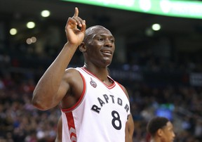 Toronto Raptors center Bismack Biyombo (8) wags his finger after blocking a shot by Atlanta Hawks player Paul Millsap (not pictured) at Air Canada Centre. The Raptors beat the Hawks 104-96. Tom Szczerbowski-USA TODAY Sports