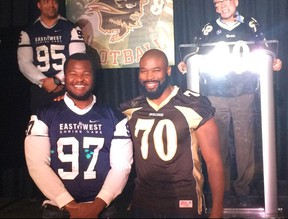 """Izzy Idonije (right) poses with Bisons defensive lineman David Onyemata, who could be the next U of M player to suit up in the NFL. Both players are Nigerian born and both learned football at a late age. """"It's incredible, isn't it,"""" Idonije asks."""