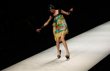 A model nearly falls as she presents a creation by Chinese designer Qi Gang during a fashion show at China Fashion Week for Spring/Summer 2012 in Beijing October 27, 2011. REUTERS/Jason Lee