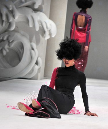 A model falls as she presents a creation by French designer Julien Fournie during the French Couture 2012 Women's Fashion Week in Singapore on November 30, 2012. AFP PHOTO / ROSLAN RAHMAN