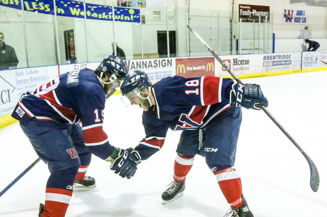 Ty Stephan and Mitchell Bowie celebrate Wetaskiwin�s 4-2 win over the St. Albert Merchants last Friday. The victory sends the Icemen through to the league finals.
