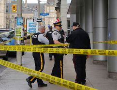 Ottawa Police and RCMP were on the scene of Metcalfe Street near Parliament Hill to investigate an RCMP officer who died of a self-inflicted gunshot. (Patrick Doyle)