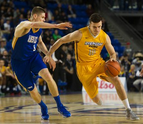 Ryerson University Rams #4 Ammanuel Diressa ( R ) drives around UBC Thunderbirds #9 Conor Morgan ( L )  in a session 1 basketball game at the CIS Men's Basketball Final 8 National Championships at UBC, Vancouver March 17 2016.  (Gerry Kahrmann  / Postmedia Network )